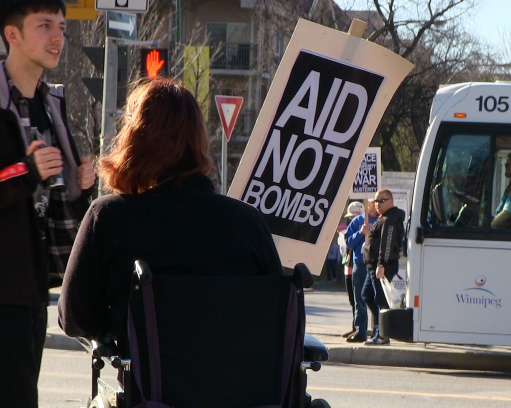 Oct. 25, 2014: Members of Peace Alliance Winnipeg distributed leaflets calling for an end to Canadian military intervention in Iraq and Syria. Photo: Paul S. Graham