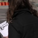 Oct. 6, 2012: A passerby reads information distributed by Peace Alliance Winnipeg in Osborne Village. Photo: Paul S. Graham