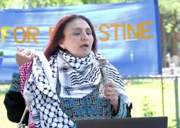 Winnipeg, June 11, 2016: Human rights activist Rana Abdulla spoke at the Winnipeg Walk for Peace on the history and significance of a traditional Palestinian scarf knows as the keffiyeh. Photo: Paul S. Graham