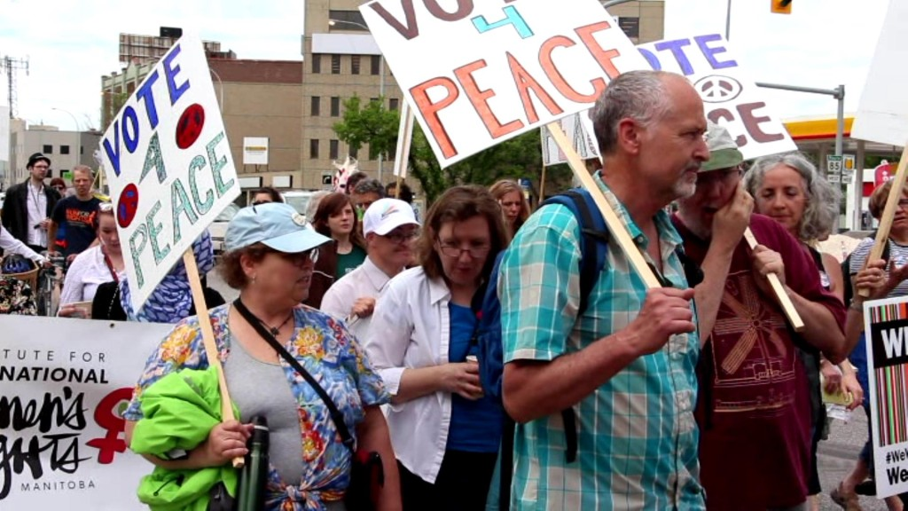 """June 13 2015: Winnipeggers say """"Vote 4 Peace"""" in the 34th annual Walk for Peace, a highlight of the Winnipeg Peace and Justice Festival. Photo: Paul S. Graham"""