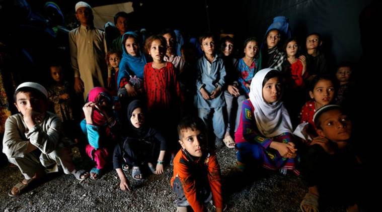 Afghan refugee children watch a short video clip about mines during a mines and explosives awareness program at a United Nations High Commissioner for Refugees (UNHCR) registration centre in Kabul, Afghanistan September 27, 2016. Picture taken September 27, 2016. REUTERS/Mohammad Ismail