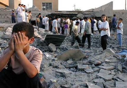 A boy weeps as others survey the damage caused by a US air strike on Fallujah in September 2004. Picture:AFP