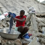 A woman washes clothes next to a house destroyed by the earthquake in Port-au-Prince January 11, 2011. Haiti will this week mark the first anniversary of the earthquake that killed around 250,000 people and wrecked much of the capital Port-au-Prince on Jan 12, 2010. Photo: Reuters/Kena Betancur