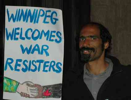 Winnipeg peace activist Michael Welch prepares to spend the night at the Manitoba Legislature in support of Corey Glass and other US war resisters in Canada. Photo: Paul Graham